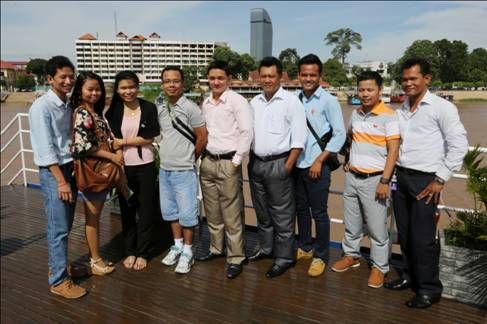 Agents posing on Indochine sundeck during the breakfast cruise